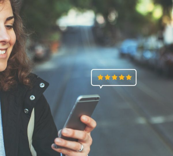 Springo - Reviews grow your business - Woman on mobile phone sending a review